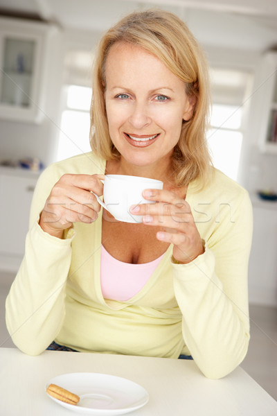 Mid age woman with coffee at home Stock photo © monkey_business