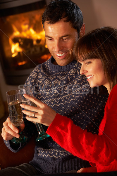 Middle Aged Couple Sitting Sofa By Cosy Log Fire With Glass Of C Stock photo © monkey_business