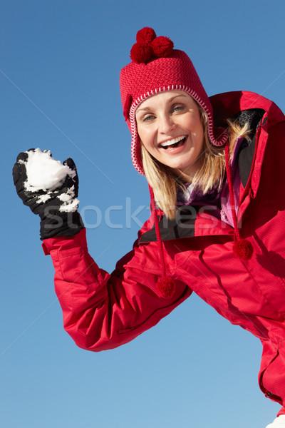 Donna palla di neve indossare caldo vestiti sci Foto d'archivio © monkey_business