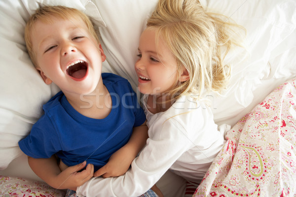 Brother And Sister Relaxing Together In Bed Stock photo © monkey_business