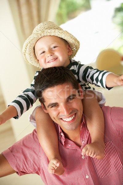 Father Giving Son Ride On Shoulders Indoors Stock photo © monkey_business