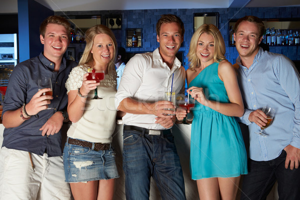Group Of Friends Enjoying Drink In Bar Stock photo © monkey_business
