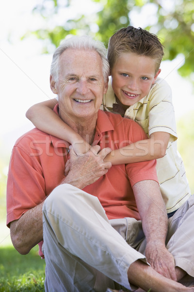 Grandfather and grandson smiling Stock photo © monkey_business