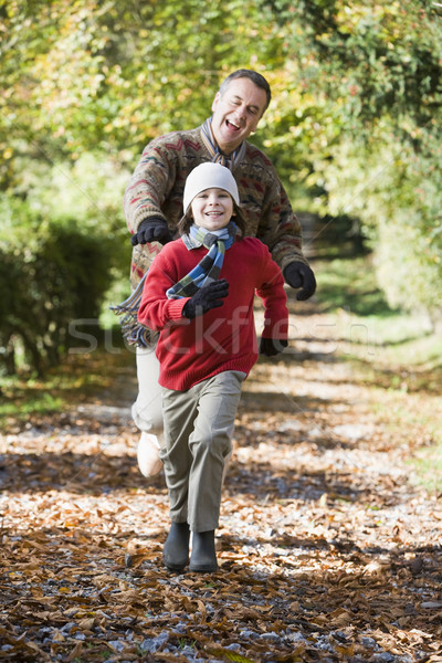 Grandfather and grandson running through woods Stock photo © monkey_business