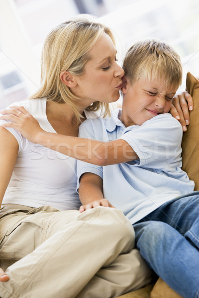 Woman kissing disgusted young boy in living room Stock photo © monkey_business