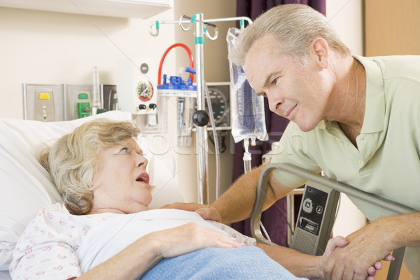 Middle Aged Man Talking To Senior Woman In Hospital Stock photo © monkey_business