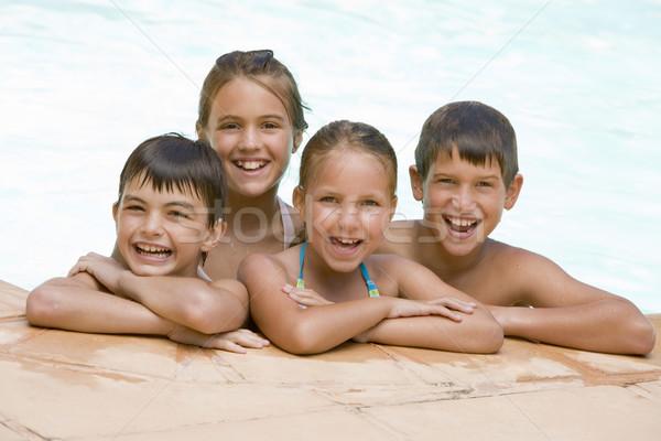 Stok fotoğraf: Dört · genç · arkadaşlar · yüzme · havuzu · gülen · çocuk