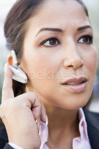 Mulher bluetooth tecnologia retrato comunicação feminino Foto stock © monkey_business