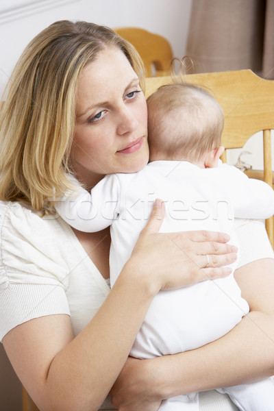 Worried Mother Holding Baby In Nursery Stock photo © monkey_business