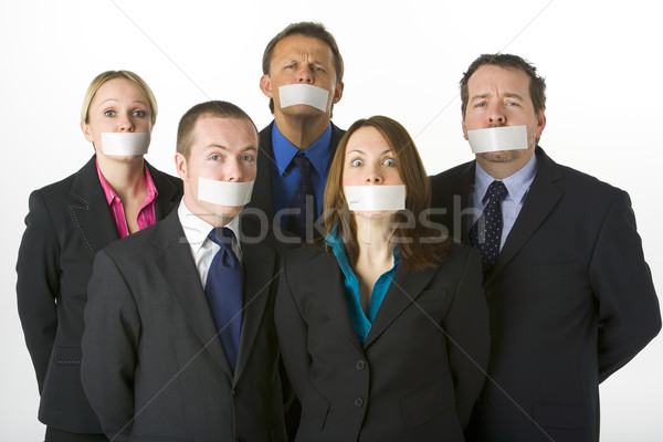 Stock photo: Group Of Business People With Their Mouths Taped Shut