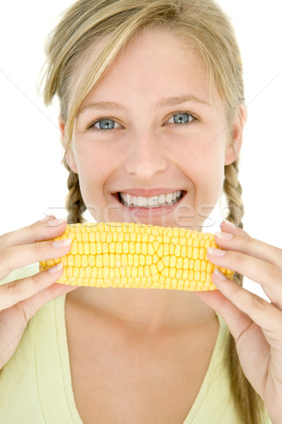 Teenage girl holding corn on cob and smiling Stock photo © monkey_business