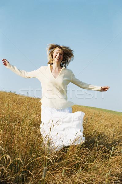 Mulher corrida ao ar livre sorrindo sorridente verão Foto stock © monkey_business