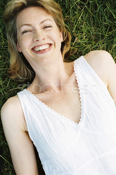 Woman lying outdoors smiling Stock photo © monkey_business