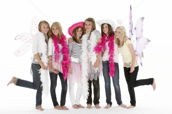 Groep vriendinnen dressing omhoog vrienden Stockfoto © monkey_business