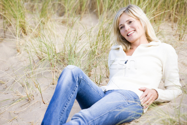 Stock photo: Woman lying on beach smiling