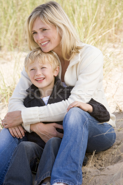 Stock photo: Mother and son sitting on beach smiling