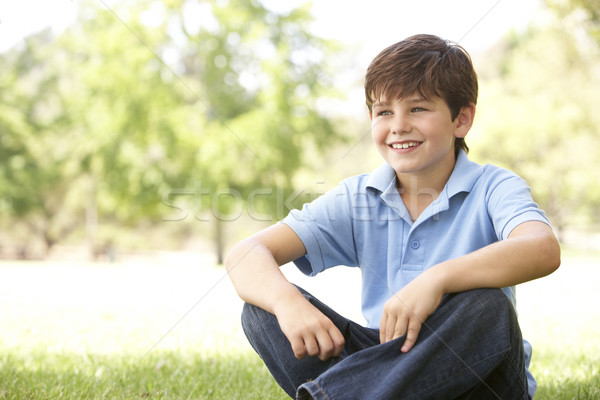Portrait Of Young Boy Sitting In Park Stock photo © monkey_business