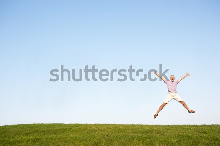 Senior woman  jumping in air Stock photo © monkey_business