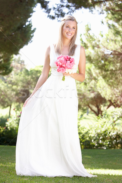 Bride Wearing Dress Holding Bouqet At Wedding Stock photo © monkey_business