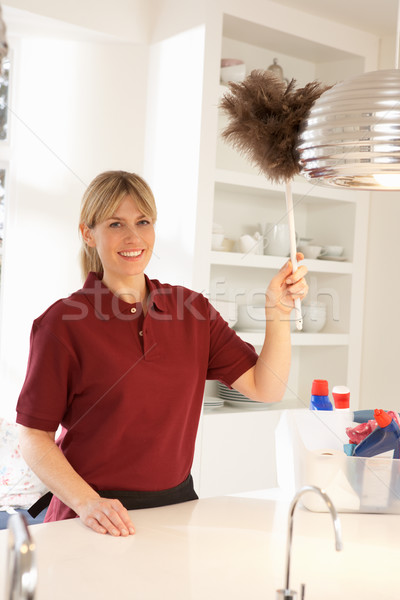 Cleaner Working In Domestic Kitchen With Feather Duster Stock photo © monkey_business