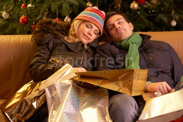 Tired Couple Returning After Christmas Shopping Trip Stock photo © monkey_business