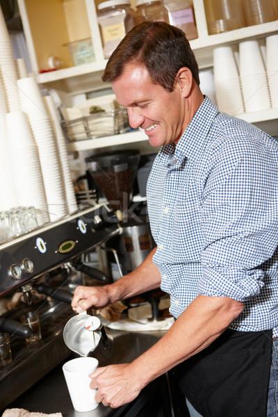 Uomo lavoro coffee shop business felice lavoro Foto d'archivio © monkey_business