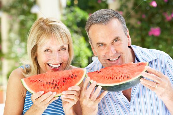 Senior Couple Enjoying Slices Of Water Melon Stock photo © monkey_business
