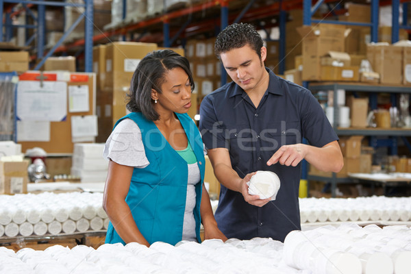 Stock photo: Factory Worker Training Colleague On Production Line