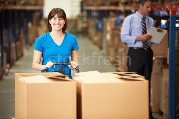 Female Worker Pulling Pallet In Warehouse Stock photo © monkey_business