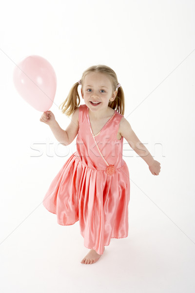 Stock photo: Young Girl Holding Party Balloon