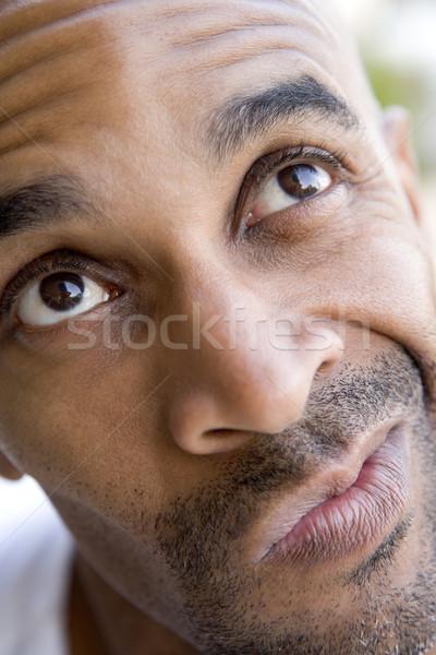 Stock photo: Head shot of man thinking