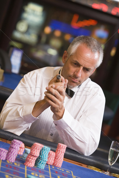 Man gambling at roulette table Stock photo © monkey_business