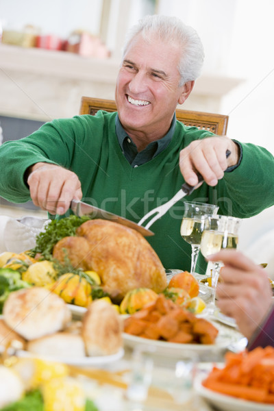 Man Carving Up Turkey At Christmas Dinner Stock photo © monkey_business