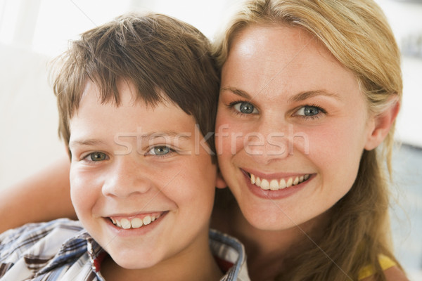 Woman and young boy in living room smiling Stock photo © monkey_business