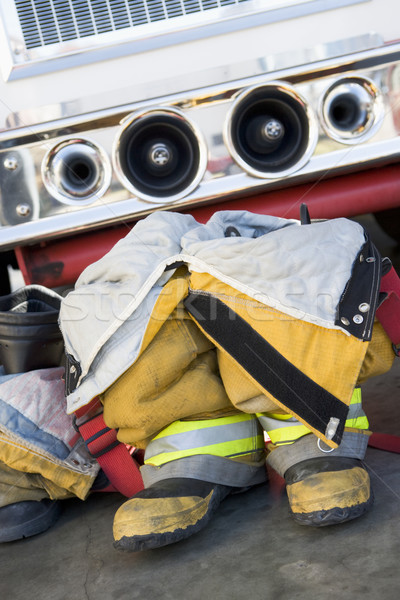 Stock photo: Empty firefighter's boots and uniform next to fire engine