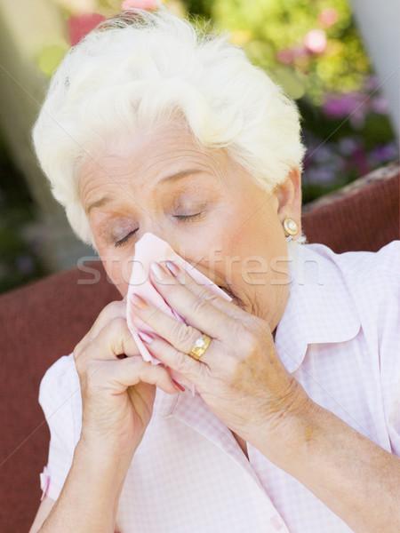 Femme moucher santé malade supérieurs couleur Photo stock © monkey_business
