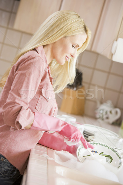 Woman Cleaning Dishes Stock photo © monkey_business