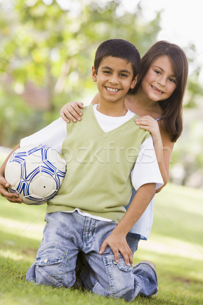 Stok fotoğraf: çocuklar · oynama · futbol · park · bakıyor