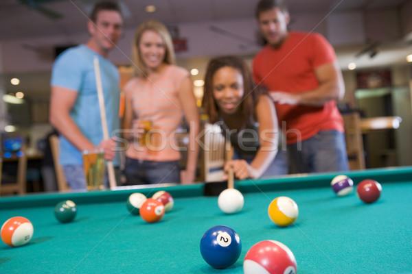 Giovani coppie giocare piscina bar focus Foto d'archivio © monkey_business