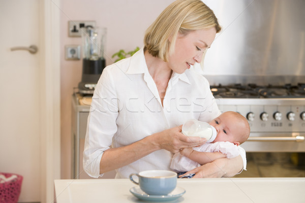 Anya etetés baba konyha kávé nő Stock fotó © monkey_business
