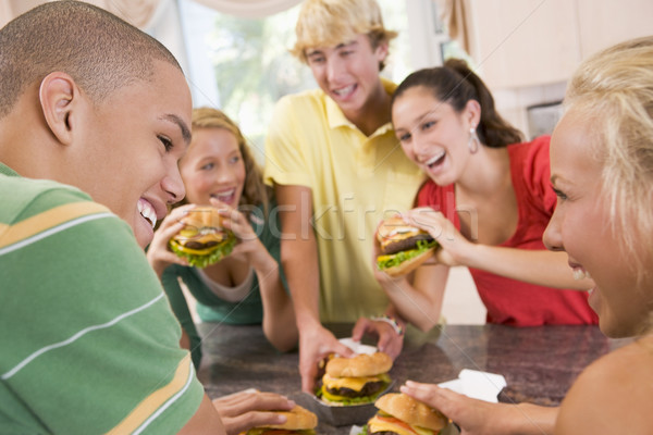 Teenagers Eating Burgers Stock photo © monkey_business