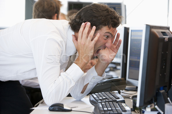 Businessman Looking Shocked At Monitor Stock photo © monkey_business