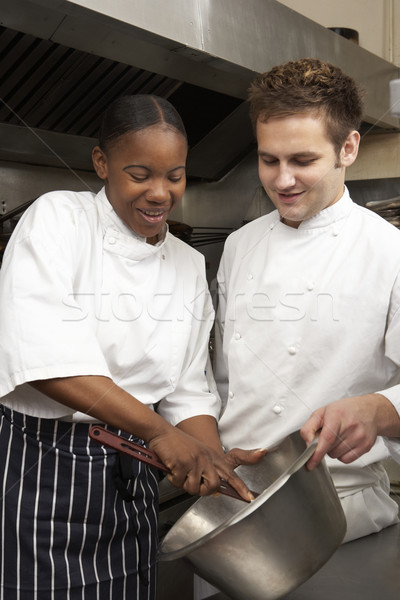 Chef Instructing Trainee In Restaurant Kitchen Stock photo © monkey_business