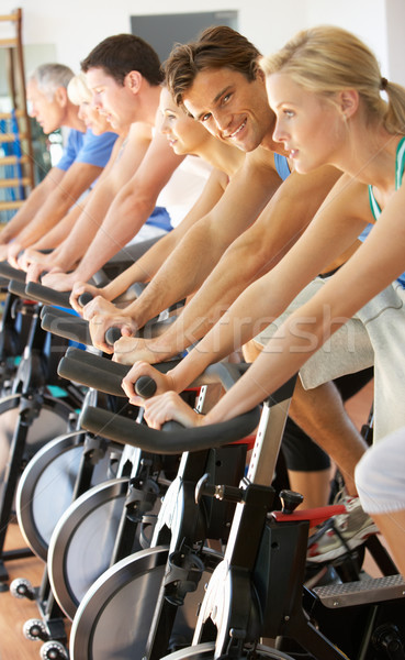 Man Cycling In Spinning Class In Gym Stock photo © monkey_business