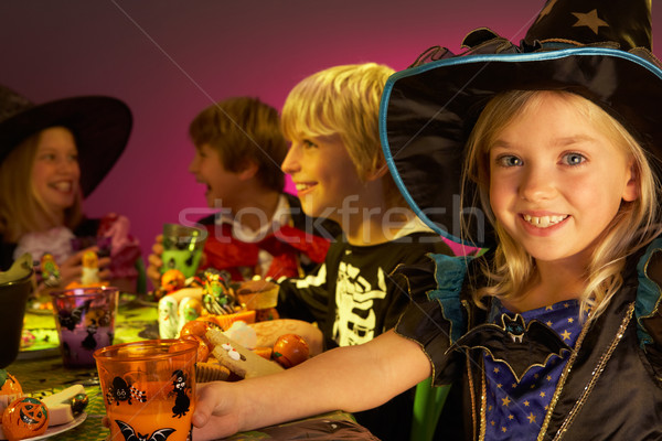 Halloween party with children having fun in fancy costumes Stock photo © monkey_business