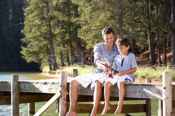 Syn ojca połowów wraz człowiek szczęśliwy słońce Zdjęcia stock © monkey_business