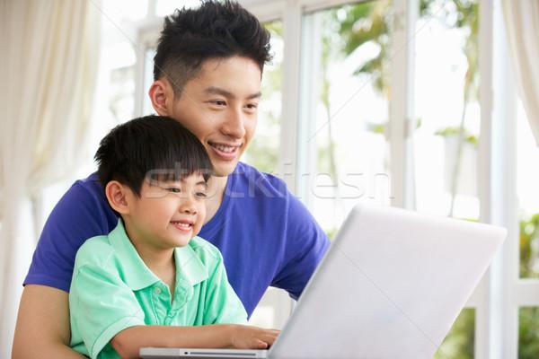 Kínai apa fia ül asztal laptopot használ otthon Stock fotó © monkey_business