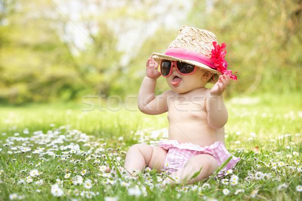 Baby Girl In Summer Dress Sitting In Field Wearing Sunglasses An Stock photo © monkey_business