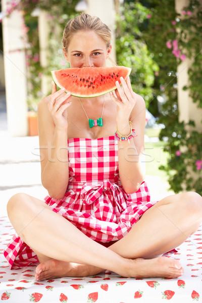 Woman Enjoying Slice Of Water Melon Stock photo © monkey_business