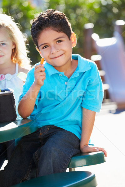 Elementary Pupil Sitting At Table Eating Lunch Stock photo © monkey_business